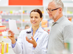 pharmacist assisting old man in buying medicine