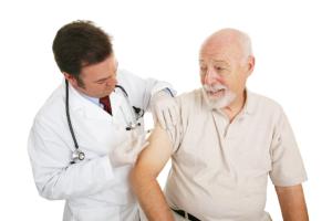 senior having vaccine
