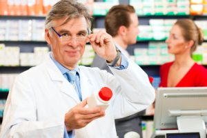 pharmacist holding a medicine